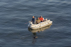 Kiev, Ukraine - September 30, 2015: Men go fishing in an inflatable boat Royalty Free Stock Image
