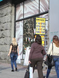 Kiev, Ukraine - September 11, 2013: Passers-by looking at the billboard with the exchange rate Royalty Free Stock Images