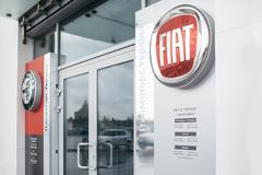 Kiev, Ukraine - September 11, 2018. Picture of Fiat dealer store with emblem at front door. It is clean and has some. Miracle effect stock images