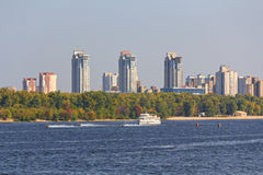 Kiev, Ukraine - September 18, 2015: Tourist boat athletes and water scooters along the Dnieper Royalty Free Stock Image