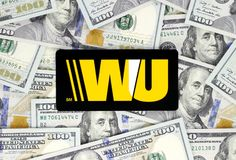 Western Union logo printed on paper, cut and placed on money background stock photos