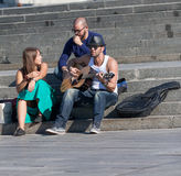 Kiev, Ukraine - September 10, 2013: Young musicians playing Royalty Free Stock Photo
