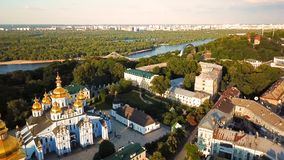 Kiev Ukraine St. Michael`s Golden-Domed Monastery. View from above. aerial video footage. Landscape city view to Dnipro. And Pishokhidnyy Parkovyi bridge stock footage