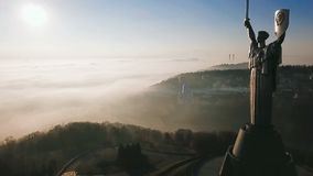 Kiev Ukraine. View from the hill with The Motherland Monument. erial video footage. Deep fog. Beautiful autumn morning. The camera flies past stock video footage