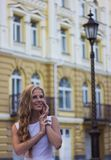 Young caucasian girl having fun in the city center royalty free stock photo