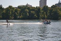 Kievskaya nature. Water. Dnieper. Recreation. Fresh air. Summer. Heat. stroll. Building. Water skiing Stock Photography