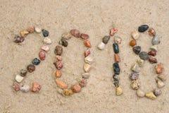 Kiezelsteen 2018 op zand selectieve nadruk Stock Afbeeldingen
