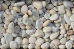 Kiezelsteenstenen, Wit stenen en marmer, Overzeese stenenachtergrond royalty-vrije stock fotografie