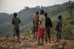 KIGALI, RWANDA - SEPTEMBER 6, 2015: Unidentified child. The Rwandan kids watching the sky. stock photo