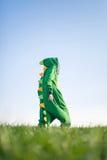 Kigurumi del dragón de la muchacha Foto de archivo