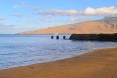 Kihei beach Maui Hawaii. Scenic view of Kihei beach on island on Maui, Hawaii. Old wharf in background Royalty Free Stock Photo