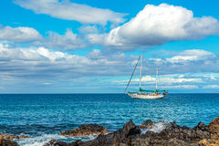 Kihei Sailboat. A sailboat moored off the coast of Kamaole Beach in Kihei on Maui, Hawaii Stock Photography
