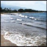 Kihei surf. Closeup view of the surf breaking onto the sandy beach in Kihei, Maui, Hawaii (USA Stock Images