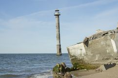 Kiipsaare Lighthouse in Saaremaa Estonia. Kiipsaare lighthouse is lika a leaning tower of Pisa, but it is not even on a ground. The sea has taken the ground and Stock Image