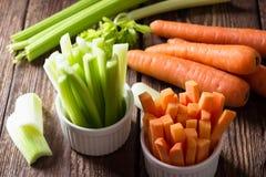 Kije marchewki i seler zdjęcia stock
