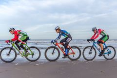 Beach racing bike competition riders in beach race in The Hague, the Netherlands. Kijkduin, The Hague, the Netherlands - 28  January 2018: Beach racing bike Royalty Free Stock Images