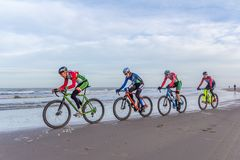 Beach racing bike competition riders in beach race in The Hague, the Netherlands. Kijkduin, The Hague, the Netherlands - 28  January 2018: Beach racing bike Stock Images