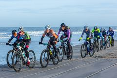 Beach racing bike competition riders in beach race in The Hague, the Netherlands. Kijkduin, The Hague, the Netherlands - 28  January 2018: Beach racing bike Stock Photos