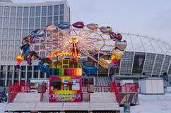 Kijowski Ukraina, Styczeń - 2016: Gdy carousel wolno kończy swój ruchu Styczeń 03, 2016, Kijów, Ukraina Zdjęcie Stock