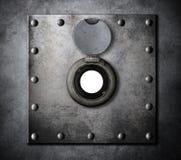 Kikhål- eller piphål i bepansrad dörr för metall Arkivbild
