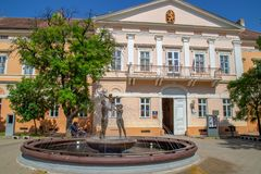 Facade of museum in Kikinda, Serbia. KIKINDA / VOJVODINA, SERBIA - APRIL 28, 2018: Facade of museum with fountain and sculpture in front royalty free stock photo