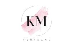 Kilómetro K M Watercolor Letter Logo Design con el modelo circular del cepillo Imagen de archivo libre de regalías