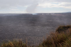 Kilauea Caldera. View from the steaming bluff into the caldera of the Kilauea volcano. The blue smoke in the background stems from the active lava eruptions Stock Photo