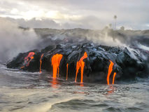 Kilauea Hawaii. Sea view of Kilauea Volcano in Big Island, Hawaii, United States. A restless volcano that has been in business since 1983. Shot taken at sunset Royalty Free Stock Photos