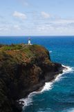 Kilauea Lighthouse And The Pacific Ocean. Kilauea lighthouse sits on the rocks jutting into the Pacific Ocean on the island of Kauai on a sunny day stock image