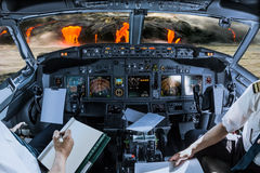 Kilauea Volcano cockpit. Airplane cockpit flying on Kilauea Volcano, Big Island, Hawaii, United States by sunset, with pilots arms and blank white papers for Stock Photography