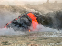 Kilauea Volcano Hawaii. Sea view of Kilauea Volcano in Big Island, Hawaii, United States. Shot taken at sunset when the lava glows in the dark as jumps into the Stock Photography