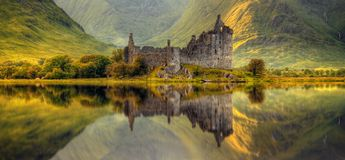 Kilchurn Castle reflections. Kilchurn Castle reflection in Loch Awe at sunrise, Highlands, Scotland Royalty Free Stock Photo