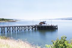 Kilcreggan pier old victorian structure in Argyll and Bute on the River Clyde during the summer. Uk stock photography