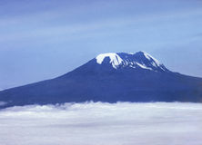 Kilimanjaro. Mount Kilimanjaro from the air above a sea of clouds Stock Photo