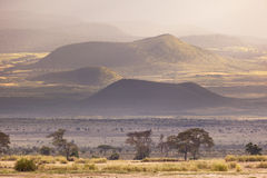Kilimanjaro Craters. Volcanic craters on the flank of Mount Kilimanjaro seen from Amboseli National Park in Kenya with beautiful evening light Stock Image