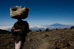 Kilimanjaro sherpa. Sherpa carrying camping gear on Kilimanjaro at 4,000 meters Royalty Free Stock Photo