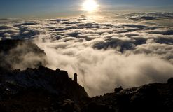 Kilimanjaro sunset from summit. Sunset on the Roof of Africa looking out over the clouds from the summit of Mt. Kilimanjaro Stock Photo