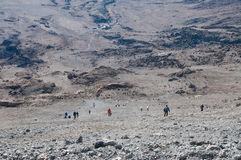 Kilimanjaro trekkers descending from Gilmans Point. The long and steep descent from Gilmans Point back to camp at Kibo Hut Royalty Free Stock Photos