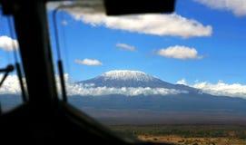 Kilimanjaro Window View. Kilimanjaro through the window, taken from a plain about to land in Kenya on the maasai mara royalty free stock images