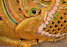 Kilin and na-ga art thai lanna. Photos patterned line thai Thailand to eat with ferocious serpent swallowing sharp fangs decorated with crystals and gold colored stock photos