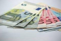 Kilka euro rachunki na białym stole zdjęcie stock