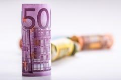Kilkaset euro banknoty brogujący wartością Euro pieniądze pojęcie Rolka euro banknoty banknot waluty euro konceptualny 55 10 Obraz Royalty Free