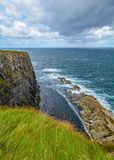 Cliffs and waves near Kilkee, County Clare, Ireland Royalty Free Stock Image