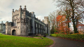 Kilkenny castle in Ireland. Kilkenny Castle and gardens in autumn with heavy clouds. It is one of the most visited tourist sites in Ireland Royalty Free Stock Photos