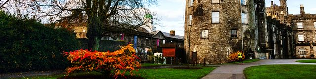 Kilkenny Castle and gardens in autumn with heavy clouds. It is one of the most visited tourist sites in Ireland. Kilkenny, Ireland. Kilkenny Castle and gardens Royalty Free Stock Images