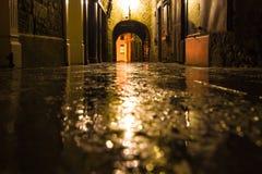 Kilkenny Ireland Rainy Alley. Focus on wet ground along dark medieval alley on a rainy night, Butter Slip, Kilkenny Ireland Stock Images