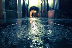 Kilkenny Ireland Rainy Alley. Focus on wet ground along dark medieval alley on a rainy night, Butter Slip, Kilkenny Ireland stock photos