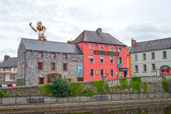 Kilkenny riverside bar with inflatable cat Stock Images