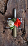 Kill me softly. Bullet wrapped like a gift Royalty Free Stock Images