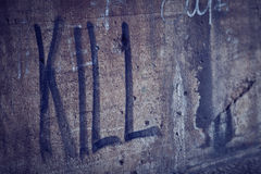 Kill Spray Lettering in a Grunge Wall Royalty Free Stock Photos
